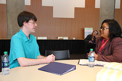 A mentor and student engage in a mock-interview.