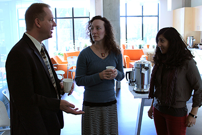Scott Bellman and two AccessERC participants chat over coffee.