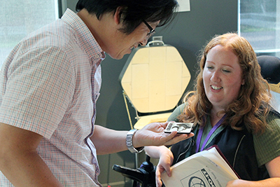 Jungsoo Kim, a visiting scholar from South Korea, attends a summer study session and learns about makerspaces with DO-IT staff member Kayla Brown.