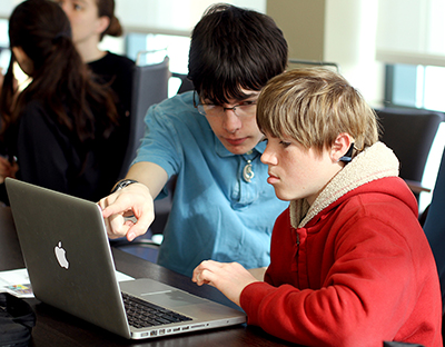 Two students work together on a coding project at an AccessComputing workshop.