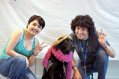 Naomi, her service dog, and Ambassador Adrian pose for a photo. Naomi and Libby enjoy many activities together.