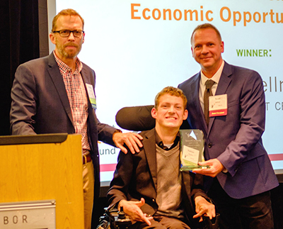 -	Michael Richardson and Daman Wandke present Scott Bellman with the Frances Pennell Economic Opportunity Award.