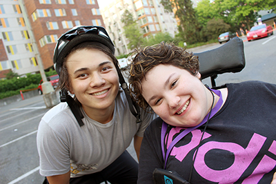 Maribel (right) poses with Intern Takashi during the Outdoors for All accessible biking session at Summer Study 2018.