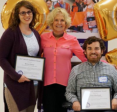 Sheryl Burgstahler congratulates Trailblazer recipients Krista and Sean at DO-IT's 25th anniversary party.