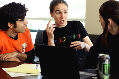 Kyle Rector works with a participant at a deaf coding workshop.