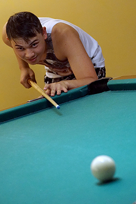 Takashi, a Phase 2 Scholar, plays billiards during Summer Study 2017.