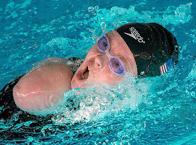 Photo of DO-IT Scholar Kayla turning to take a breath during a swimming competition
