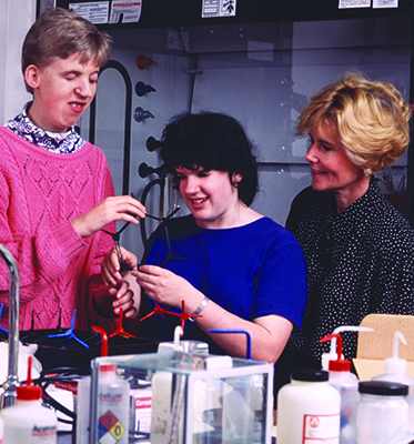 Sheryl helps two students complete a science experiment during Summer Study 1995.