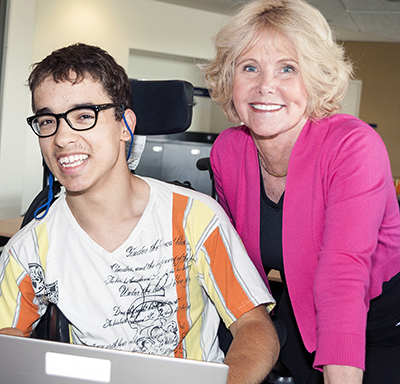 Sheryl with a student during Summer Study 2016.