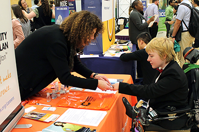 A student meets a job recruiter at a diversity career fair.