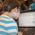 A student views large print text on a computer.