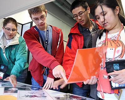 Students looking at images together in a lab.