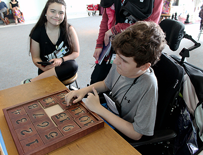 Two students work to figure out a puzzle.