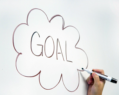 "Image of ""GOAL"" written in a thought bubble on a whiteboard"