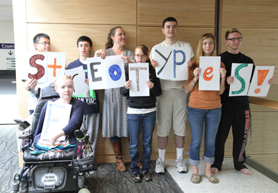 "Eight students of different heights and abilities hold up the letters that spell ""Stereotypes!"""