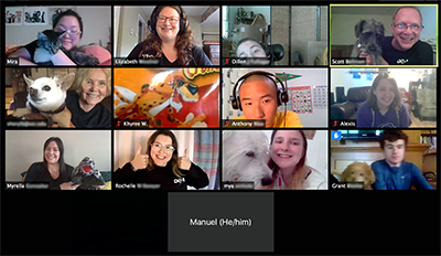 A Zoom screenshot showing 13 people smiling at the camera and holding up their various pets.
