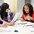 Image of two students signing to communicate during a project