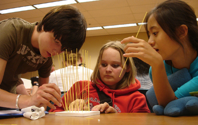 Photo of students working on an experiment.