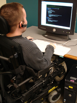 Photo of student in a wheelchair using a computer.