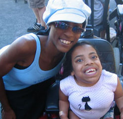 Photo of two students smiling for the camera.