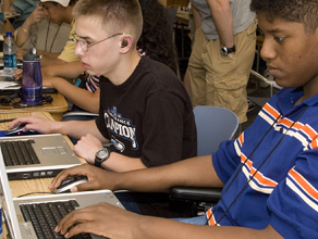 Photo of students working on laptop computers.