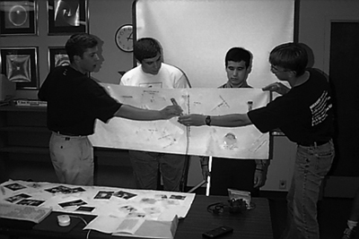 Photo of students making a group presentation.