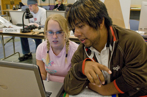 Photo of student at a laptop computer.