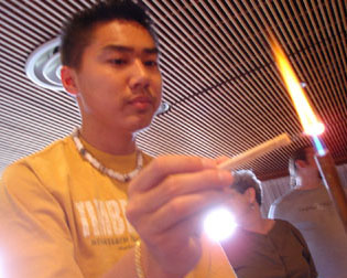 Picture of student conducting an experiment with a Bunsen burner.