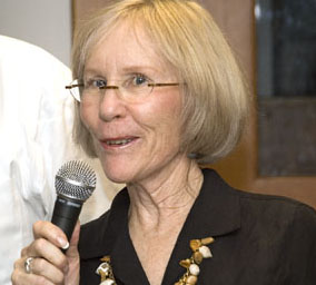 Picture of woman speaking into a microphone.