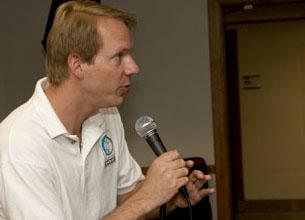 DO-iT Scott Bellman speaks into a microphone.