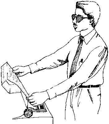A man reading a braille device