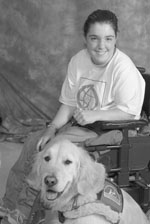 2004 DO-IT Scholar Maryann sits in her wheelchair with her golden retriever by her side.