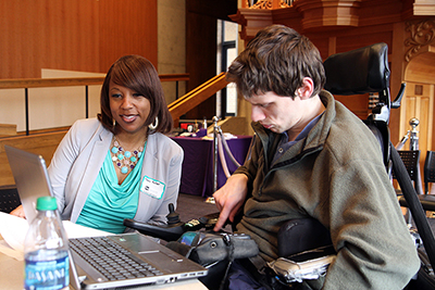 A participant communicates with a mentor through an augmentative communication device.