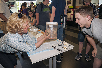 PI Sheryl Burgstahler shows a brain in a jar to a student.