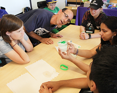 Image of students conducting an oceanography experiment.