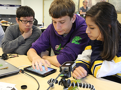 Image of three students using accessible technolog the EXO Labs