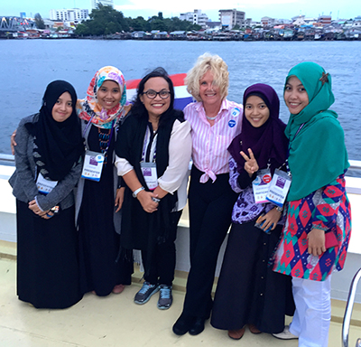 Sheryl Burgstahler stands with 5 other attendees of the First International Conference on Special Education in Bangkok.