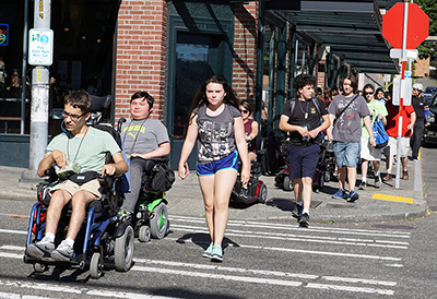 Students with disabilities cross the street.