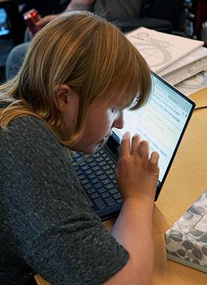 A student views a computer close up.