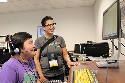 An instructor shows a student how to use a specific technology.