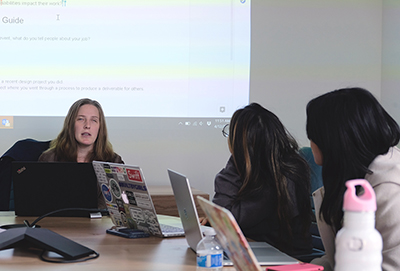 Postdoctoral student Cynthia Bennett teaches students computing.