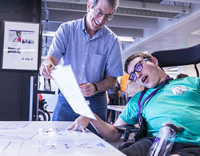 Eric Chudler of the Center for Neurotechnology works with a high school student.