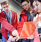 Three students work on an engineering project together