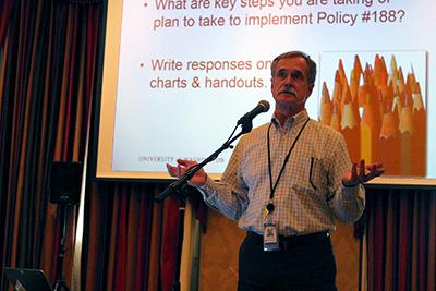 Aaron Powell, UW Interm Vice President for UW-IT and CIO, addresses the group.