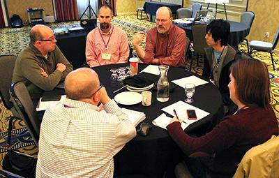 A group shares ideas around a table.