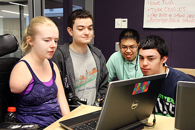 Several students work on the computer.