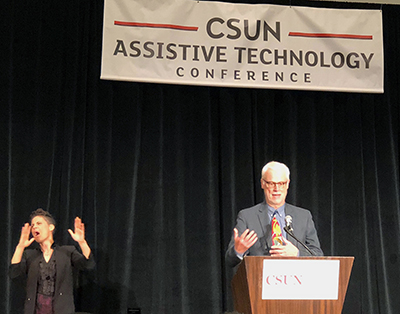Richard Ladner accepts an award at the CSUN Assistive Technology conference.