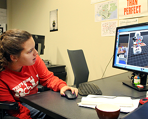 Image of a student using a computer for a robotics demo