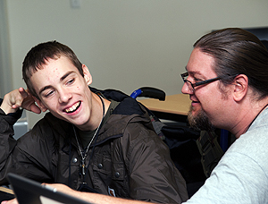 Image of a faculty member consulting a student