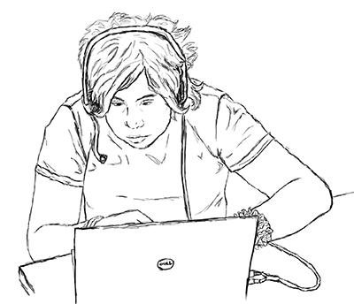 A student uses a headset to speak on his computer.